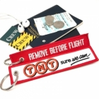 TNT Sure we can REMOVE BEFORE FLIGHT attendant pilot luggage bag tag keychain
