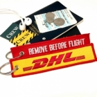 DHL REMOVE BEFORE FLIGHT attendant pilot luggage bag tag keychain