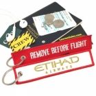 Etihad Airways REMOVE BEFORE FLIGHT attendant pilot luggage bag tag keychain